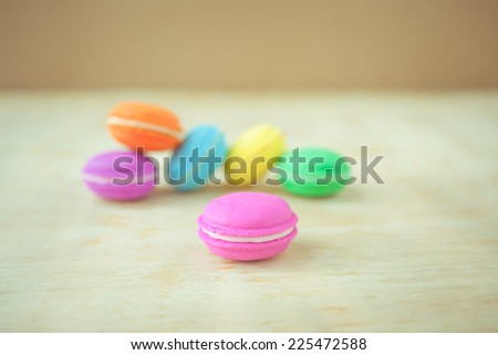 selective focus colorful french macaron on  wooden  background pastel color style.