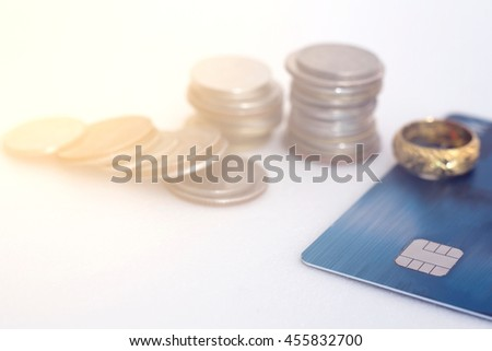Selective focus credit card with currency coin on white background,Gradient filter effect. - stock photo