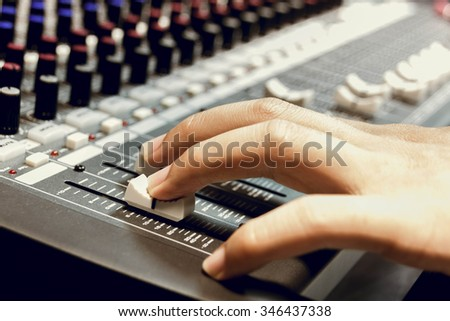 selective focus finger sound tuning of sound mixer - stock photo