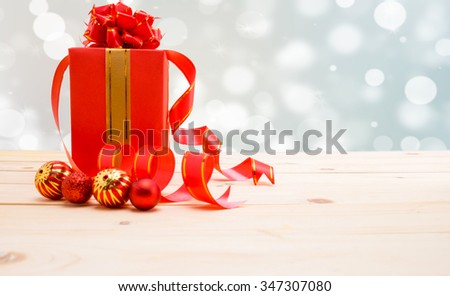 Selective focus.Gift boxes with ribbons and christmas decor on wooden background.Space for text.