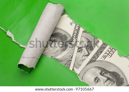 Selective focus image, focus on eyes. Money in  rupture  of green paper close-up. - stock photo