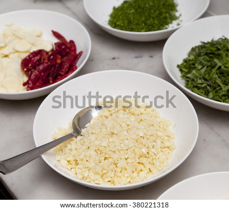 Selective focus image of chopped garlic and many kinds of ingredient - stock photo