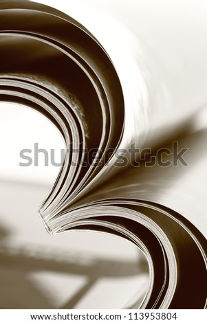 Selective focus image of magazine folded into a heart shape - stock photo