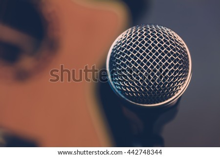 selective focus microphone and blur electric guitar music background.