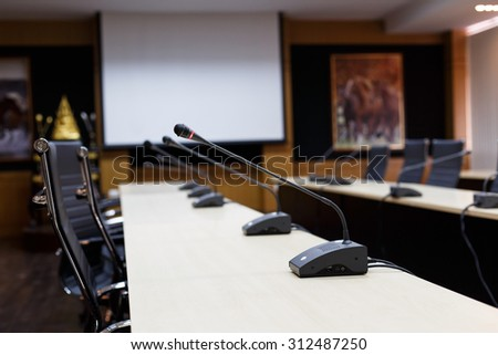 Selective focus microphone for meeting room.Meeting room. - stock photo
