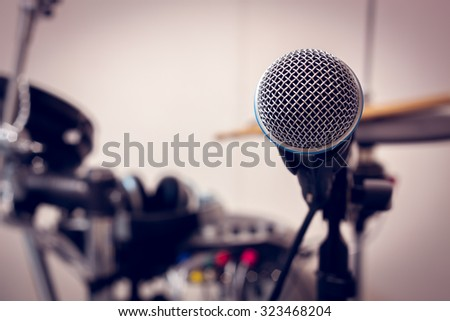 selective focus microphone on blur drum background. - stock photo