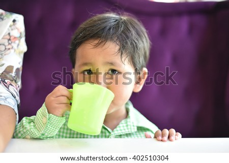Selective focus of boy drinking glass of water