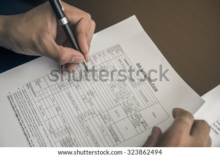 selective focus of Business man signing a contract - stock photo