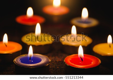 Selective focus of Candle flame light at night with night background.