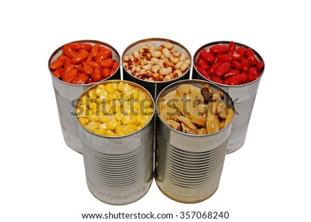 Selective focus of canned corn, beans and mushrooms on a white background - stock photo