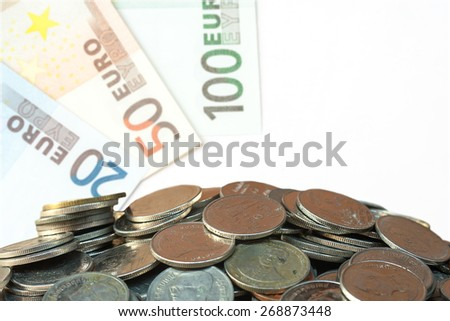 selective focus of coins over euro banknote background.,money concept - stock photo