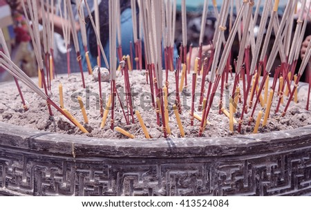Selective focus of incense  and candle in the incense burner. Temple in Thailand. soft focus. Art photo. - stock photo