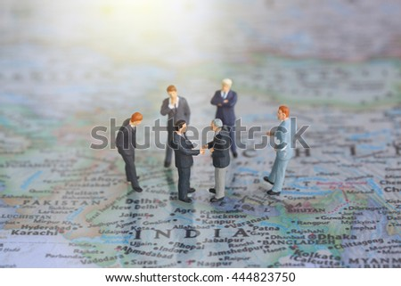 Selective focus of miniature businessman handshake and India world map background as commitment, agreement and partnership Concept - stock photo