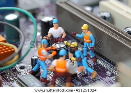 Selective focus of miniature engineer and worker fixed chip and  mainboard computer and use for business background. - stock photo