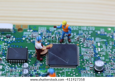 Selective focus of miniature engineer and worker fixed chip of  mainboard computer and use for business background. - stock photo