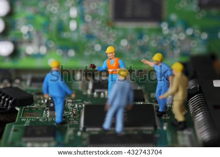Selective focus of miniature engineer meeting, discuss and worker fixed problem on chips and computer mainboard use for business and industrial background. - stock photo