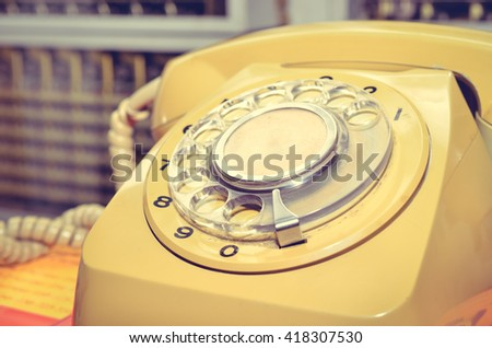 Selective focus of old telephone. Color Retro Style - stock photo