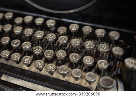 Selective focus of old typewriter, retro picture style - stock photo