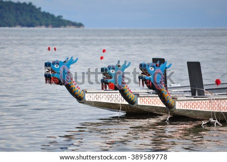 Selective focus of three dragon boat's head - stock photo