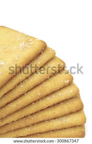 Selective focus on a stack of plain sugar biscuits on a white background , Room for text and copy space