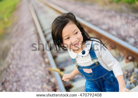 Selective focus on Asian young beautiful girl walking on the railway.