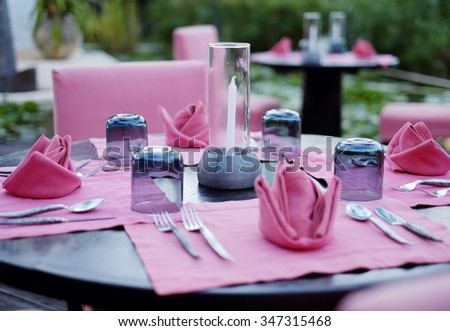 selective focus on ca cup of dining set at pool in spa hotel resort - stock photo