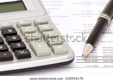 Selective focus on calculator, biro and business reports as a concept of accounting - stock photo