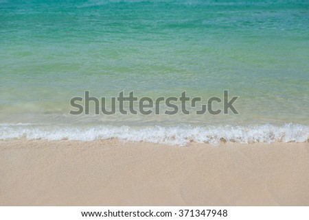 Selective focus on Gentle waves with tropical beach - stock photo