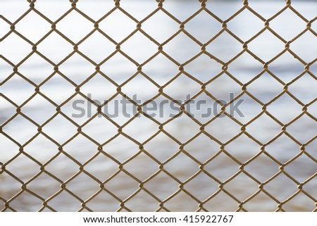Selective focus on old rusty wire fence.