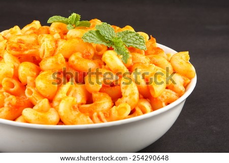 Selective focus on Pasta with tomato  and herbs sauce. - stock photo