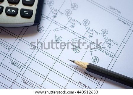 selective focus on pencil, Calculator and  pencil on process instrument diagram shop drawing, process engineering design in plant