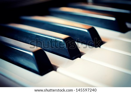 Selective focus on  piano black key in the middle  - stock photo