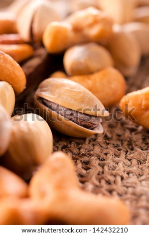 Selective focus on  pistachio in the middle - stock photo