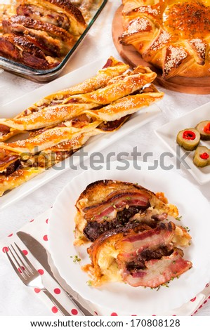 Selective focus on the baked bacon and melting cheese in plate  - stock photo