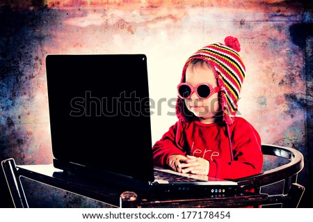 Selective focus on the child with laptop computer - stock photo