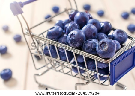 Selective focus on the front blueberry in trolley - stock photo