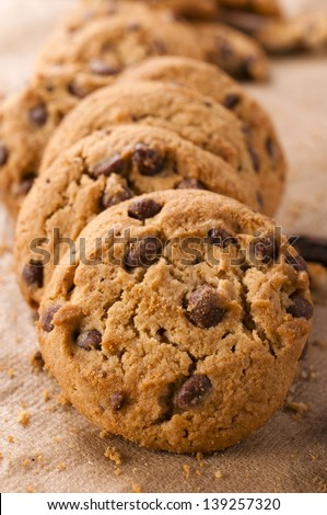 Selective focus on the front dark cookie - stock photo