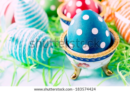 Selective focus on the front dotted blue egg