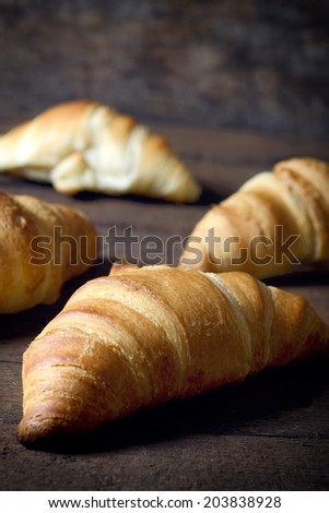 Selective focus on the front golden croissant