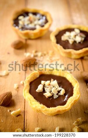 Selective focus on the front mini chocolate tart  - stock photo
