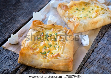 Selective focus on the front pie stuffed with cheese  - stock photo