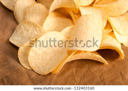 Selective focus on the front potato chips. - stock photo