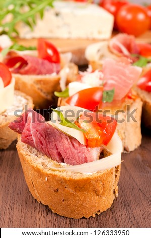 Selective focus on the front small sandwich - stock photo