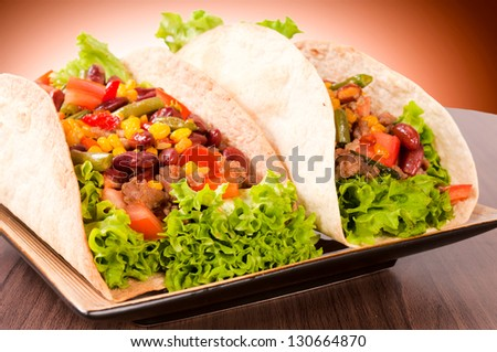 Selective focus on the left tacos sandwich - stock photo