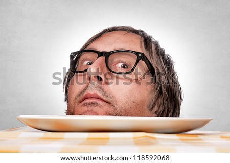 Selective focus on the mans head and blur on plate - stock photo