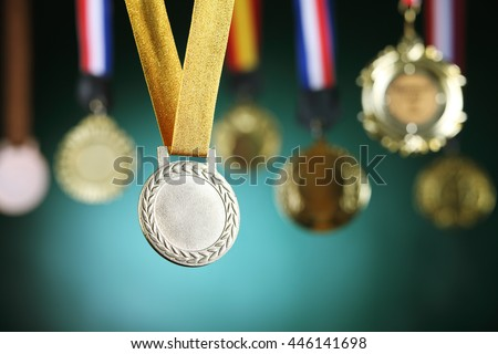 selective focus on the medal in front of blackboard