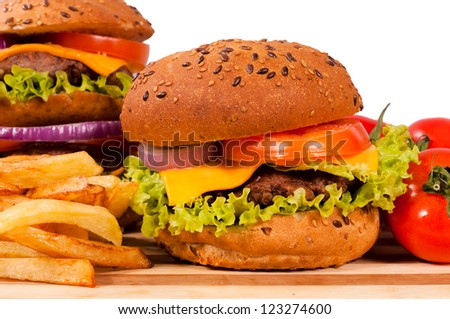 Selective focus on the right cheeseburger - stock photo