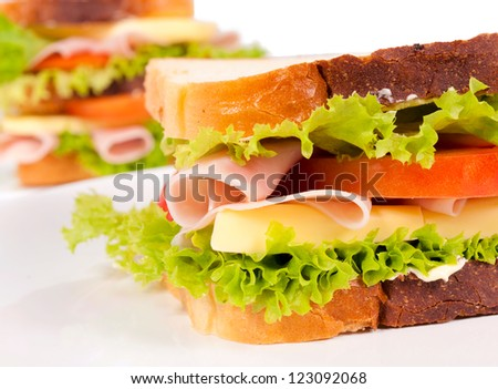 Selective focus on the right sandwich - stock photo