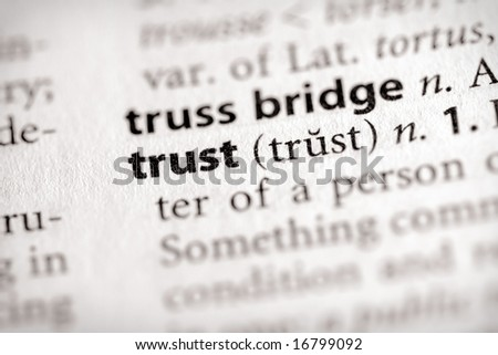 "Selective focus on the word ""trust""."
