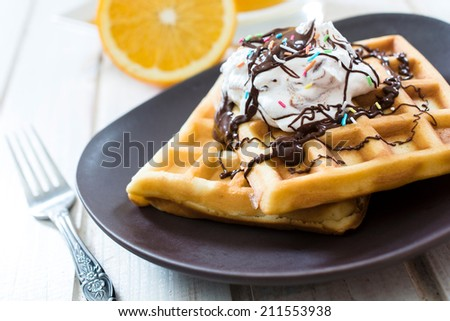 Selective focus on traditional Belgian waffles with sweet cream and melted chocolate  - stock photo